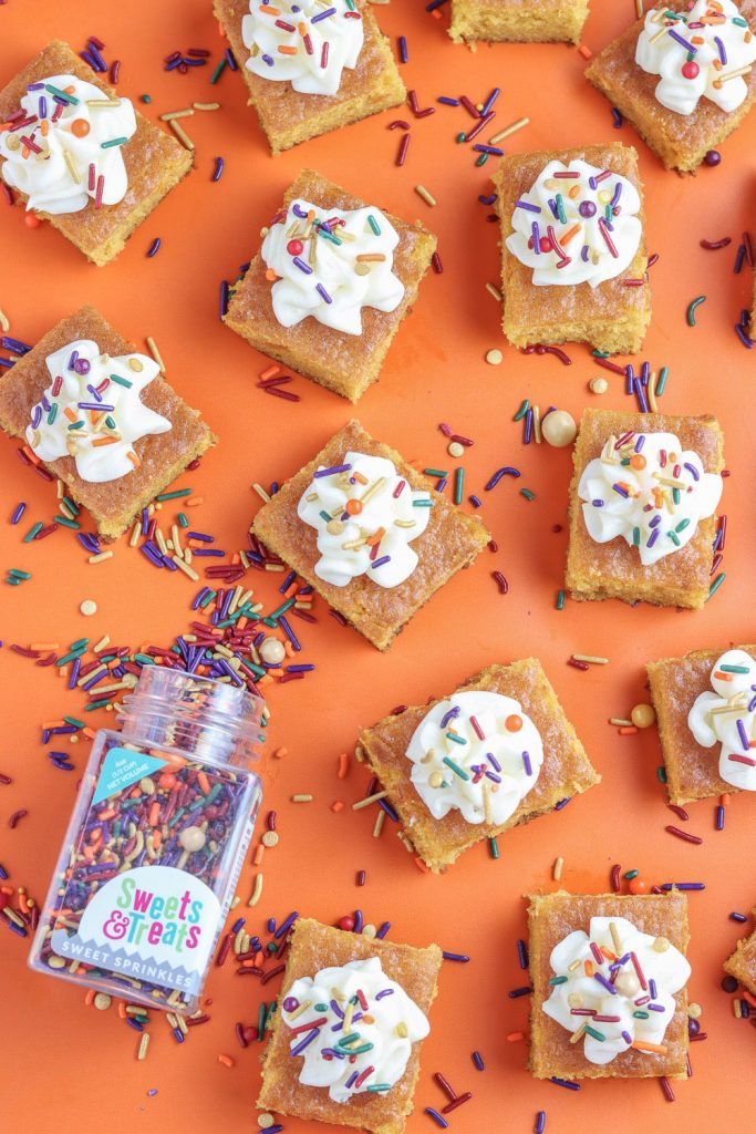 pumpkin bars with cream cheese frosting and fall sprinkles