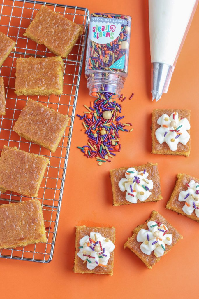 top view of square pumpkin bars before icing and sprinkles