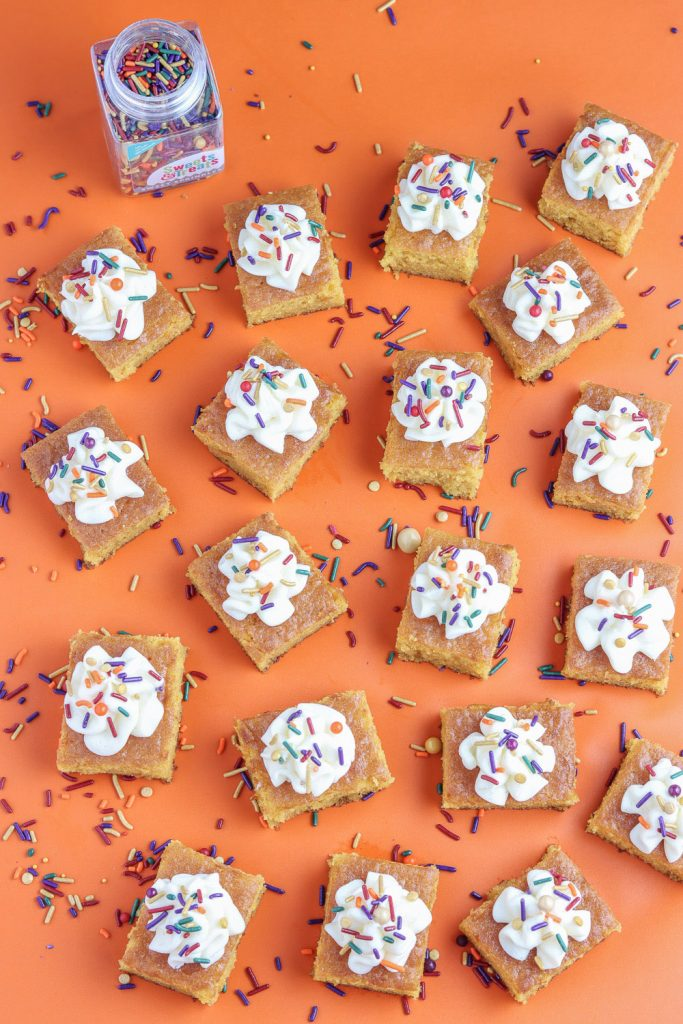 overhead view of pumpkin pie bars recipe with fall sprinkles