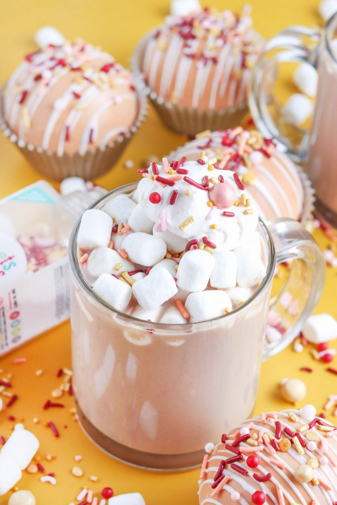 mug of pumpkin spice hot chocolate with marshmallows and sprinkles
