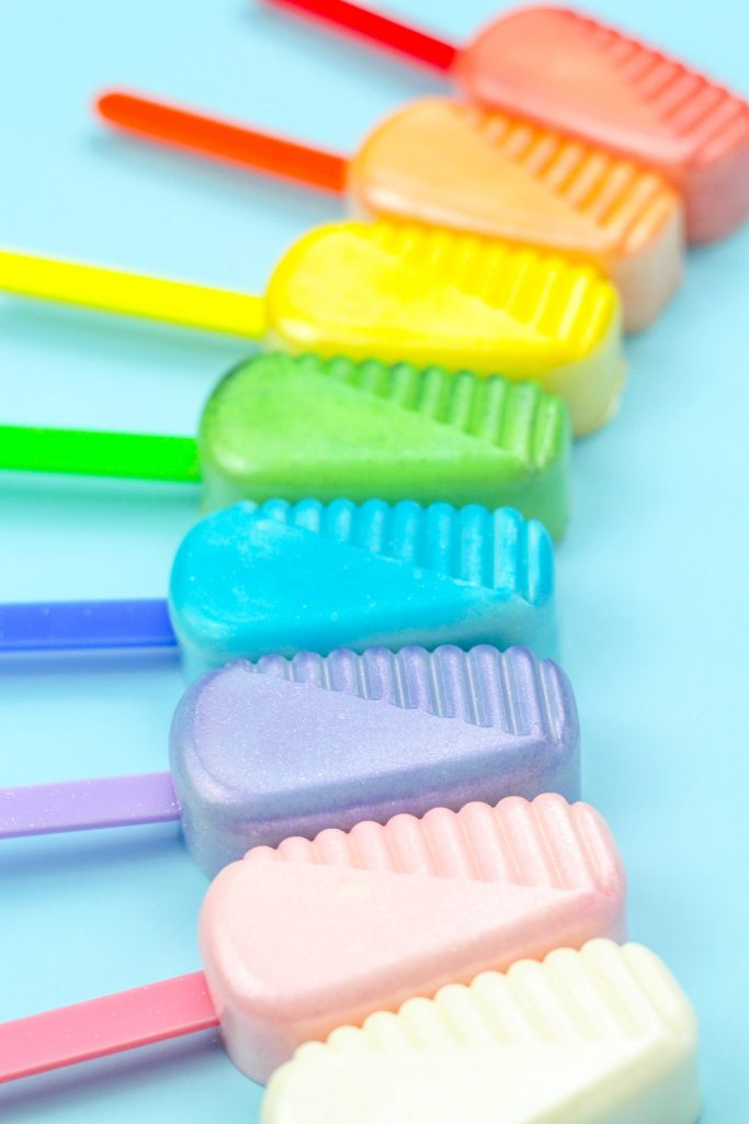 rainbow cakesicles made from luster dust in cakesicle mold