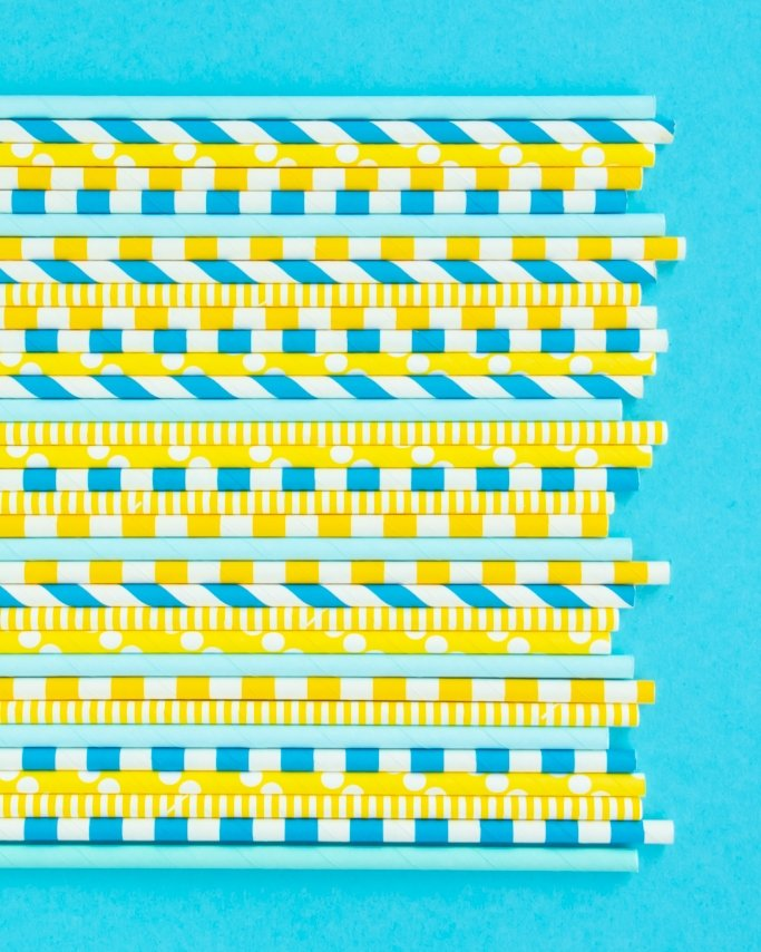Rubber duck baby shower paper straws mix on blue background