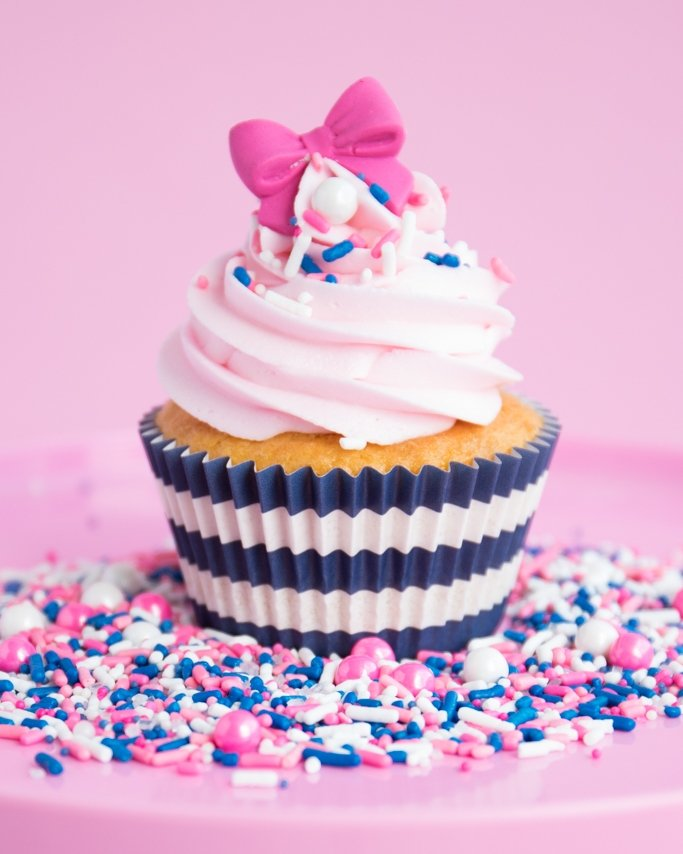 Navy & Pink Nautical Party Cupcakes on pink plate of sprinkles