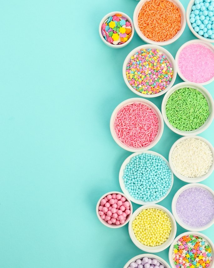 Easter sprinkles of all shapes and sizes on light blue background
