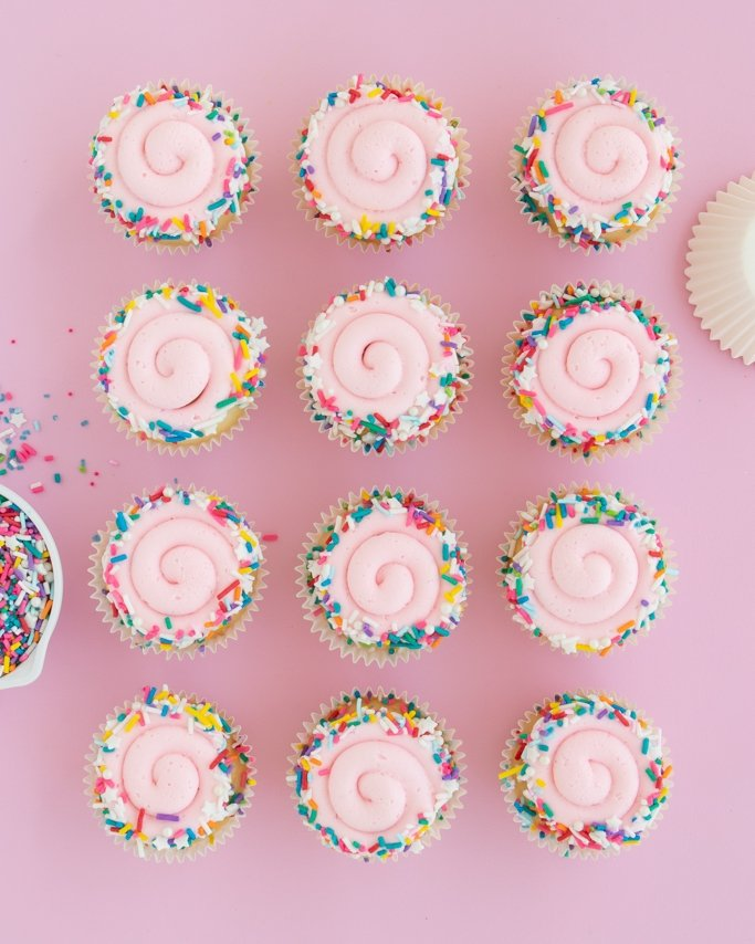 Swirl sprinkle cupcakes rolled in birthday cake sprinkles