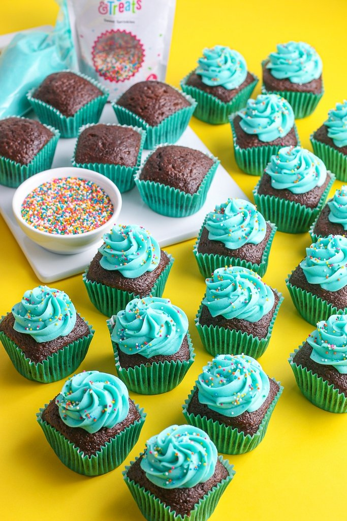 Another great view of the finished cupcakes with their blue square cupcakes liners and frosting.