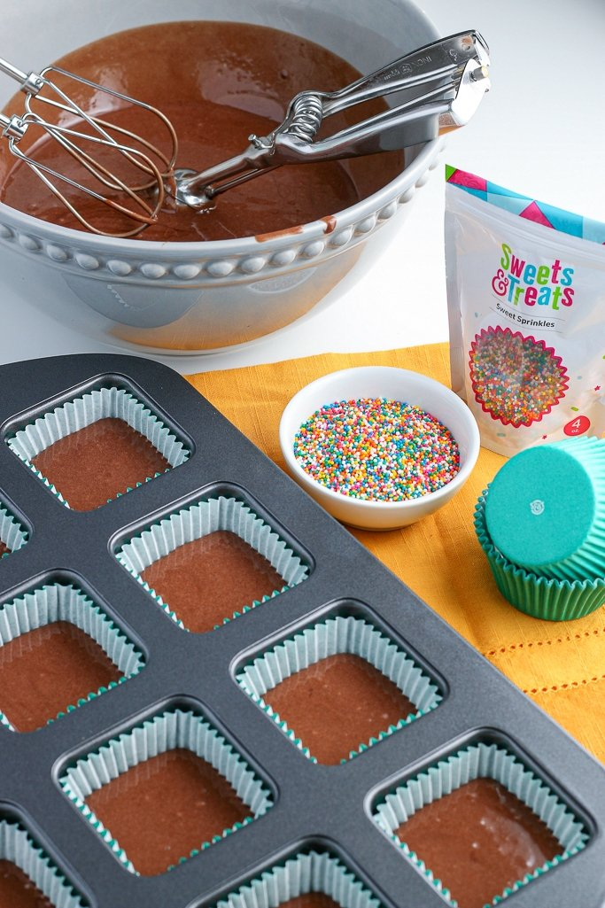 This image shows how the square cupcake liners are created when we add the batter to the square cupcake pan.