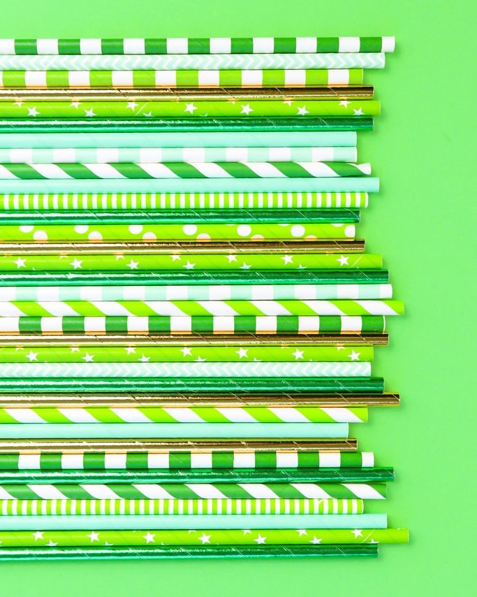 St. Patrick's Day Party Supplies - Paper Straws on green background
