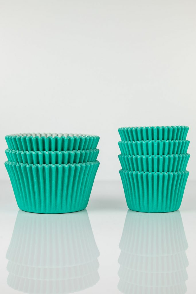 standard and mini cupcake liners being compared to each other