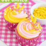 strawberry banana cupcakes in dot pink cupcake liners on pink plaid napkin