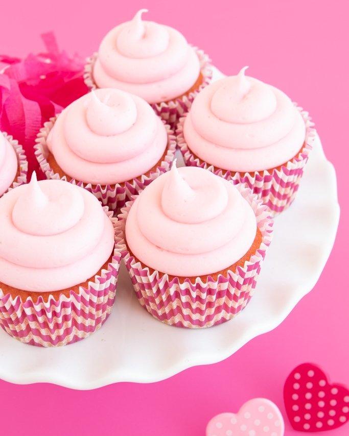 strawberry cheesecake cupcakes on white platter