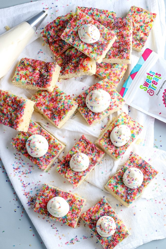 top view off cookie bars with sprinkles and frosting piped on top