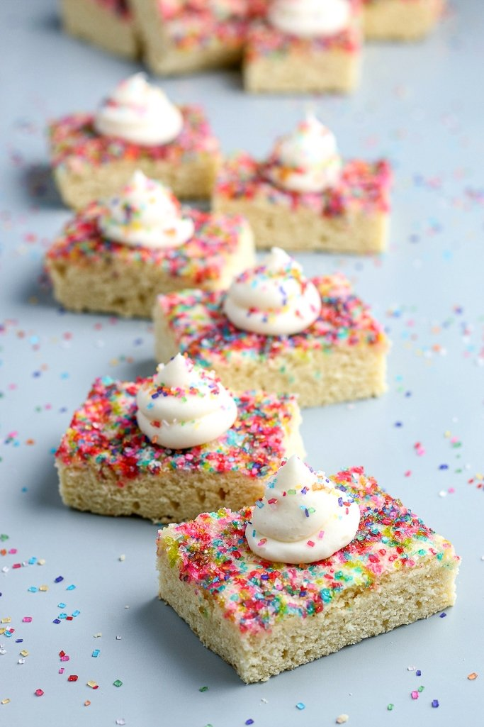 full screen shot of a half dozen cookie bars with sugar crystals and frosting on top