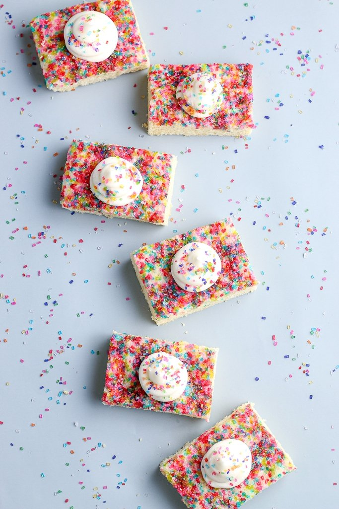 top view of sugar cookie bars with rainbow sugar crystals