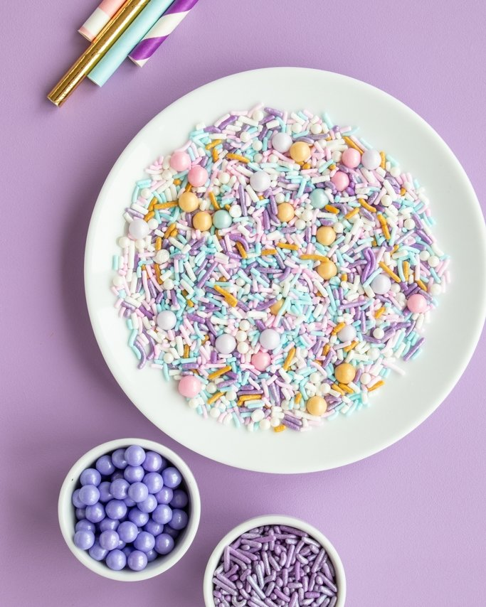 Sugar Plum Party Sprinkles in white dish on purple background