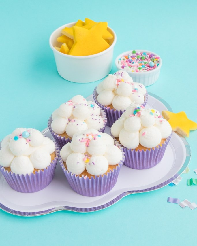Cloud Cupcakes - Sleepover Party Ideas - cloud cupcakes on cloud plate with star cookies in background