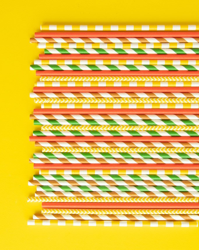 taco themed party ideas using matching paper straws in different patters on yellow background