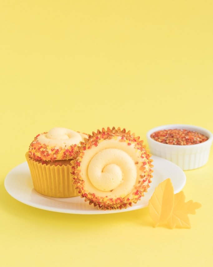 Fall Thanksgiving cupcakes on white dish and yellow background