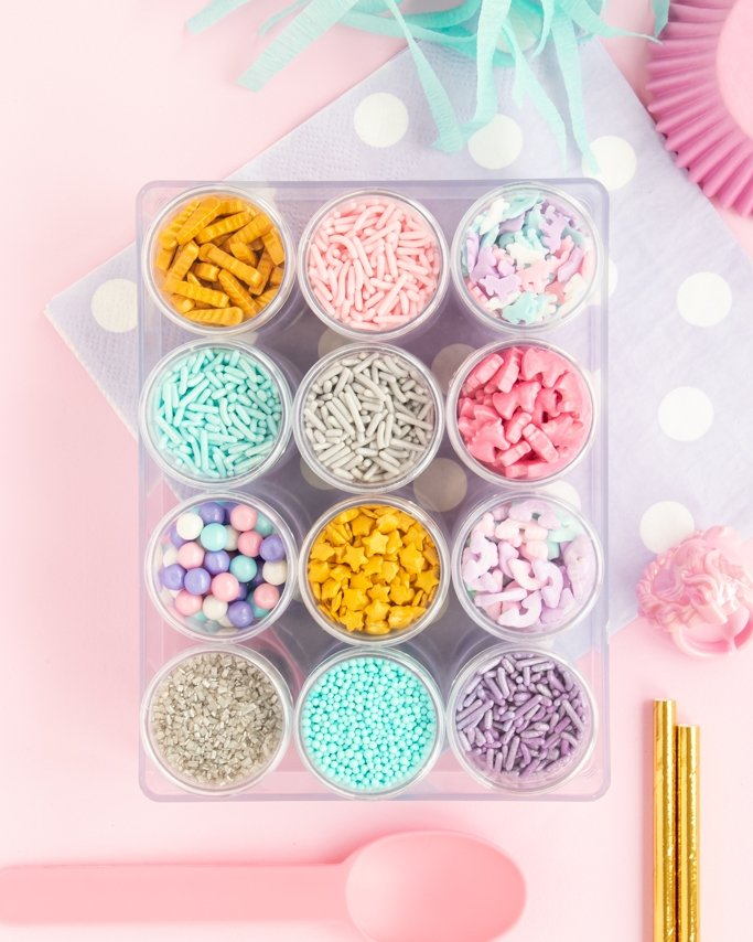 Unicorn Sprinkle Mix Kit in our plastic sprinkle box on light pink background