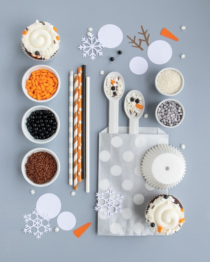 melted snowman party supplies collage on gray background