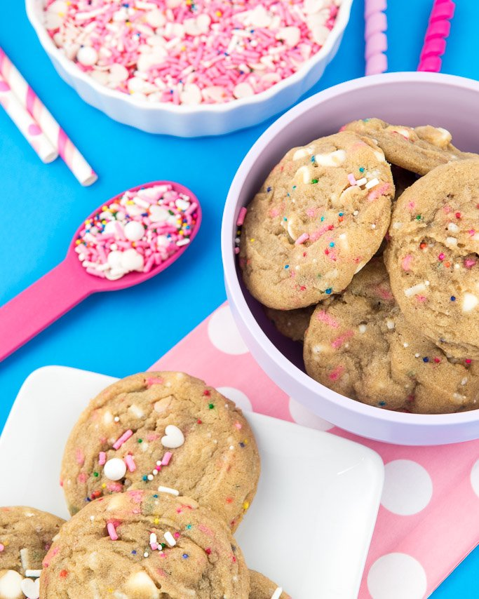 Chewy White chocolate chip cookie recipe - cookies in purple bowl and circus animal cookie sprinkles around