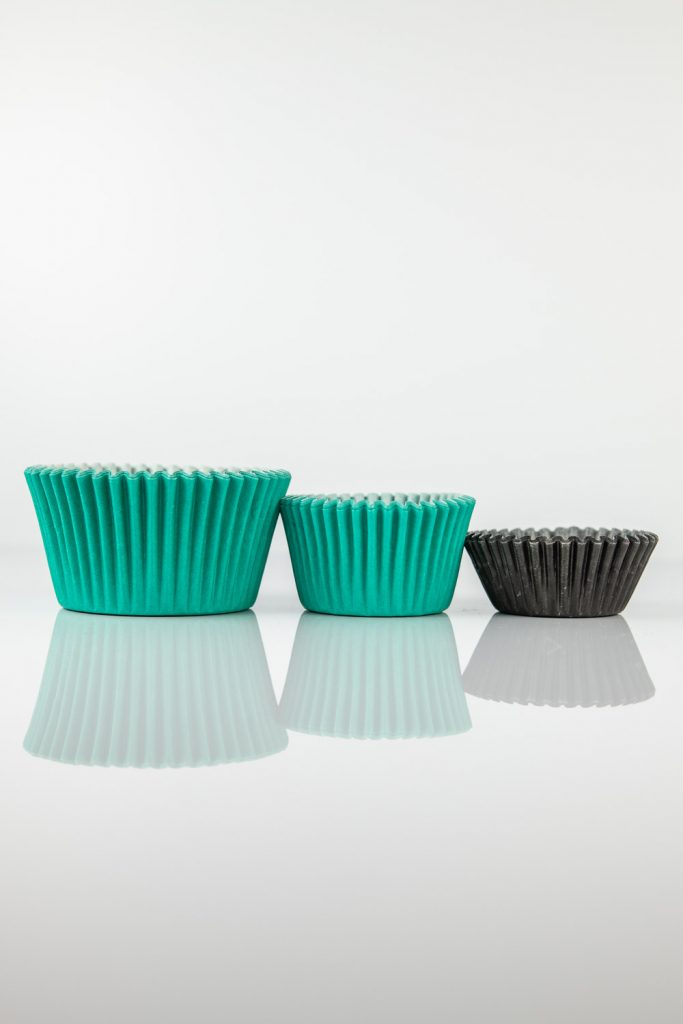 standard, mini, midi baking cups being compared to one another