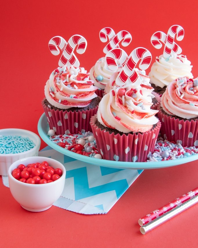 Chocolate Peppermint Cupcakes on plate of christmas sprinkles