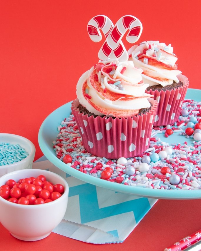 Chocolate peppermint cupcakes with peppermint buttercream in dot red liners.